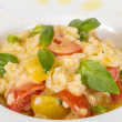Photo of delicious risotto dish with herbs and tomato on white b — Stock Photo #13275803