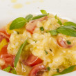 Photo of delicious risotto dish with herbs and tomato on white b — Stock Photo #13275806