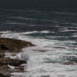 The waves fighting about deserted rocky coast of Atlantic ocean, - Stock Photo