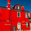 The row of colorful houses in Burano street, Italy. - Stock Photo