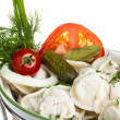 Bowl with traditional russian dish - pelmeni - Stock Photo