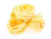 Italian pasta fettuccine nest isolated on white background — Foto Stock