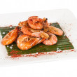 Fried black tiger prawns with herbs and spices on bananleaf — Stok Fotoğraf #14158388