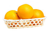 Heap of oranges in the dish on white background — Stock Photo