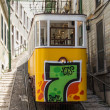 Stock Photo: LISBON, PORTUGAL - Jun 25: Traditional yellow and red trams down