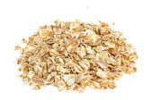 Heap of dry rolled oats isolated on white background — Stock Photo