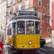 Traditional yellow and red tram — Stock Photo #15502479