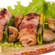 图库照片: Bacon wrapped grilled Scallops with mushrooms and bacon
