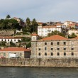 View of Porto city at the riverbank (Ribeira quarter) - Stock Photo