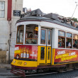 Traditional yellow and red tram — Stock Photo #15576083