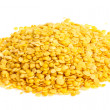 Stock Photo: Yellow lentils isolated on white background. Macro shot