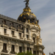 Metropolis building facade located at Madrid, Spain - 图库照片