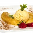 Dessert of banana, ice-cream, caramel, strawberry and mint - Stock Photo