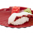 Japanese sushi with meat octopus on a white background — Stock Photo