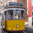 Traditional yellow and red tram — Stock Photo