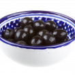 Olives black watered with olive oil in bowl isolated on whit — Stock Photo #16299717