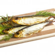 Smoked sprat - appetizing snack - Stock Photo