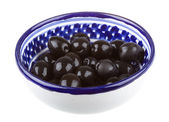 Olives black watered with olive oil in a bowl isolated on a whit — Stock Photo