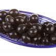 Olives black watered with olive oil in a bowl isolated on a whit — Stock fotografie