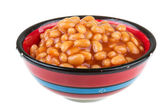 Marinated haricot beans in tomato sauce with shallots on a plate — Stock Photo