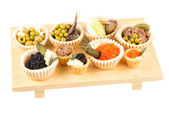 Various snacks in plate on banquet table — Stock Photo