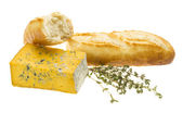Freshly baked bread, yellow cheese and thyme — Stock Photo