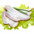 Bacon with salad leaves - Stock Photo