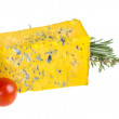 Slice of Roquefort cheese with tomato and herbs — Stock Photo #20764439