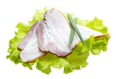 Bacon with salad leaves — Stock Photo