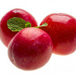 Bright ripe plum with mint - Stock Photo