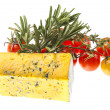 Slice of Roquefort cheese with tomato and herbs — Stock Photo #22975452