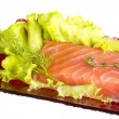 Salmon fillet garnished — Stock Photo