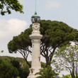 Stock Photo: Small lighthouse between trees in Rome, Italy