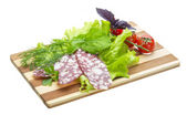 Sausages with salad and basil — Stock Photo