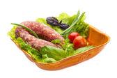 Ripe salami with salad, basil, onion and tomato — Stock Photo