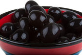 Olives black watered with olive oil in a bowl — Stock Photo