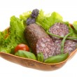 Royalty-Free Stock Photo: Ripe salami with salad, basil, onion and tomato