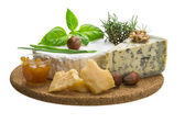Assorted cheese - brie, dor blue and hard old yellow cheese — Stock Photo