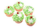 Studio isolated creamy green cupcake — Stock Photo