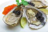 Oysters with black cavair — Stock Photo