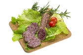 Salami with rosemary, salad and tomatoes — Stock Photo