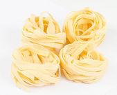 Italian pasta fettuccine nest isolated on white background — Stock Photo