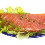 Salmon fillet garnished — Stock Photo