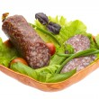 Stock Photo: Ripe salami with salad, basil, onion and tomato