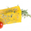 Slice of Roquefort cheese with tomato and herbs — Stock Photo #26887569