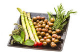 Olives, asparagus, rosemary, mint, thyme and tomato — Stock Photo