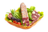 Ripe salami with salad, basil, onion and tomato — Stock Photo