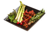 Dried tomato with asparagus and herbs — Stock Photo