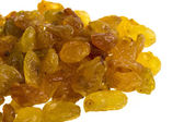 Golden raisins over white — Stock Photo