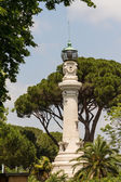Small lighthouse between the trees in Rome, Italy — Stock Photo